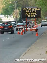 Traffic with a funny message to drivers that they will be late