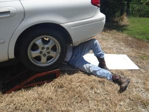 Guy working on his car.